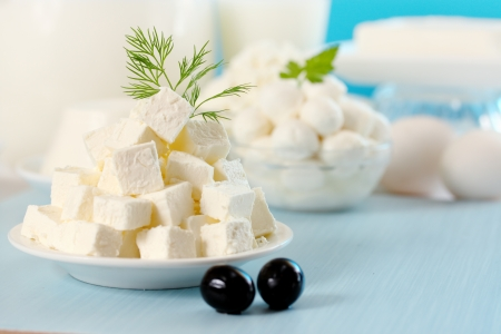 Feta cheese cut into slices on a plate Standard-Bild
