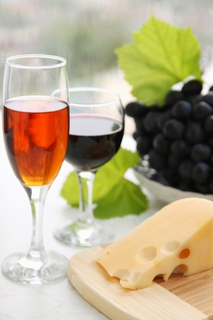 still life with  wine glass, cheese and grapes photo