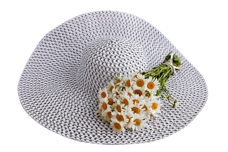Summer big hat with a bouquet of daisies photo