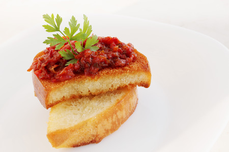 Chutney of red bell peppers on toast photo
