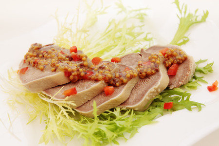 boiled pork tongue with French mustard and pepper photo