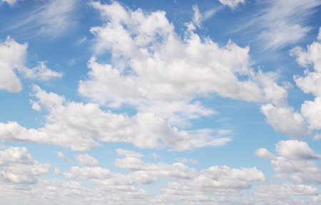 low angle views: White fluffy clouds against the blue sky Stock Photo