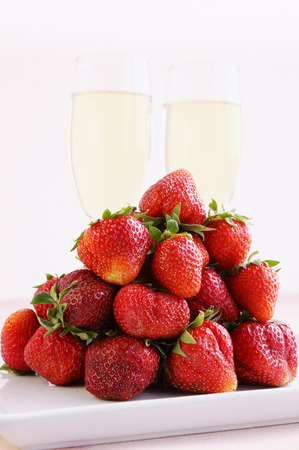 Big pile of strawberries and champagne glasses photo