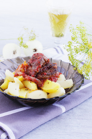 Fried potatoes with braised pork, still life photo