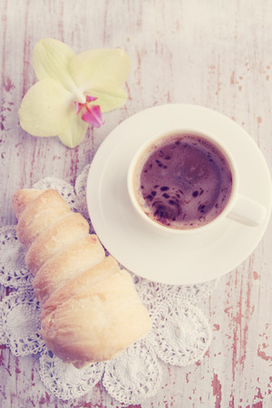 Choux pastry with cream and hot coffee photo