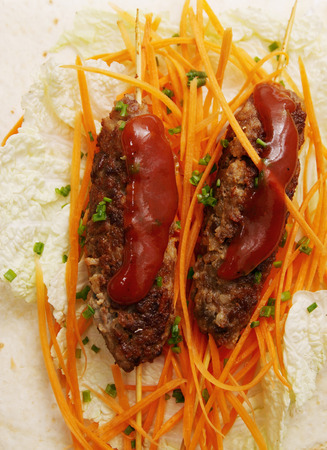 Lula kebab with salad from carrots in pita photo