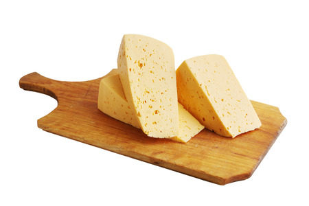 penicillium: Large chunks of cheese on a wooden board Stock Photo