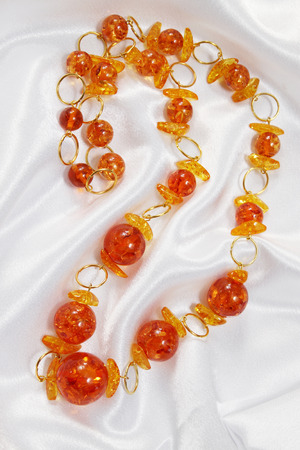 nicety: Beads of amber and silver rings on fabric