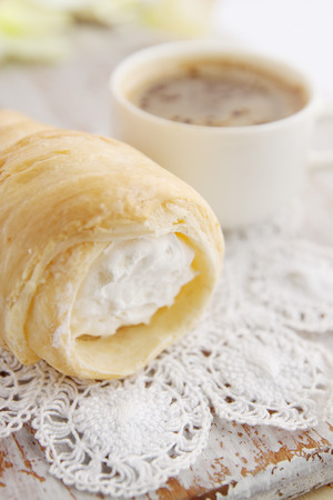 choux bun: Choux pastry with cream and hot coffee