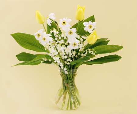 bouquet of spring flowers daffodils, tulips, lilies of the valley photo