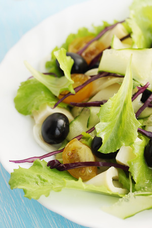 Tasty salad of tomatoes cucumber olives and cheese photo