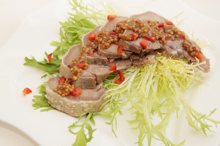 Cold appetizer of pork tongue with mustard photo