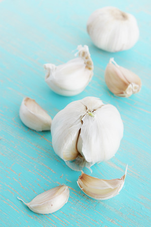 garlic on a wooden board painted blue Stock Photo