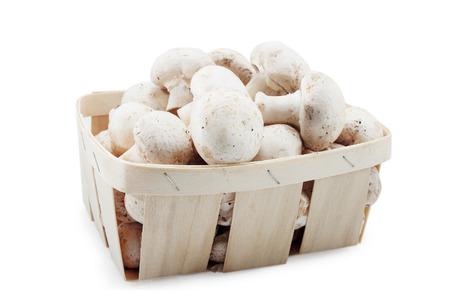 Basket with mushrooms isolated on white background