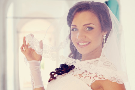 Portrait of a young beautiful bride in the arcade Stock Photo