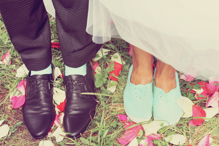 Legs bridal, groom wearing shoes, brides moccasins