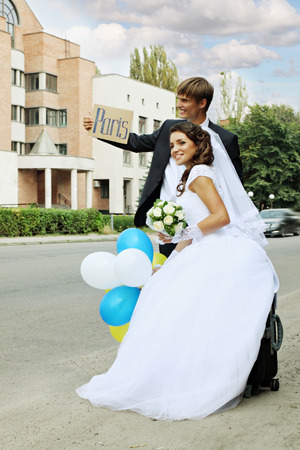 The bride and groom travel hitchhiking to Paris