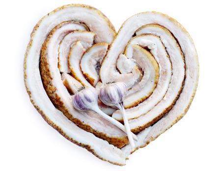 Ukrainian lard with garlic in the form of heart photo