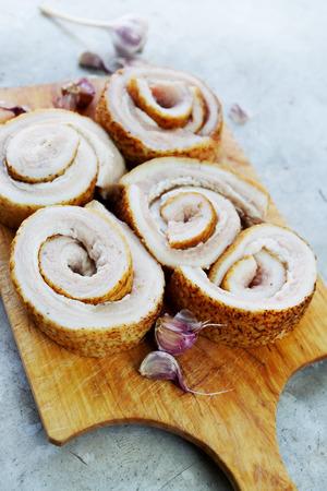 bacon love: Ukrainian lard in rolls on wooden board Stock Photo
