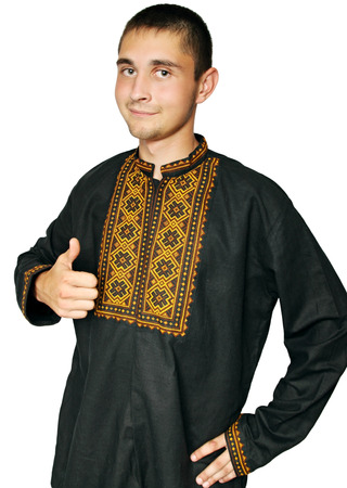 Ukrainian man in traditional dress shows thumb up gesture photo