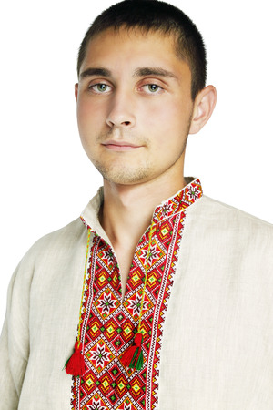 Portrait of a young man in the Ukrainian national shirt photo