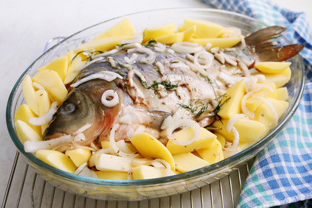 mirror carp: Pickled carp with potatoes and onions, prepared for baking
