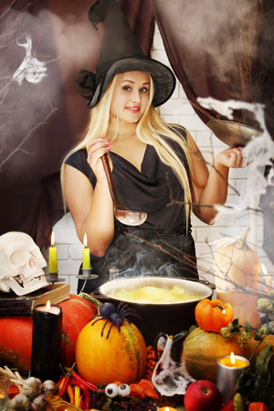 coven: beautiful Witch brew the potion in the boiler Stock Photo