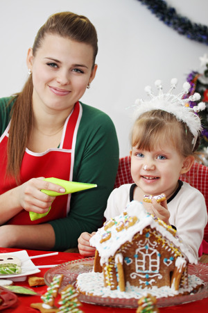 smeared: Mom with her daughter prepare ginger house