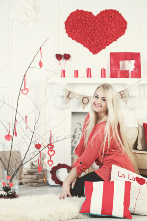 long-haired blonde decorated tree hearts Valentines Day photo