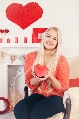 blonde woman with a box of heart-shaped photo