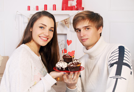 man and woman with a festive chocolate cake photo