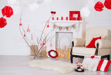 red pillows: Bright interior with fireplace decorated with Valentines Day Stock Photo