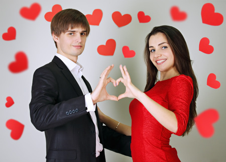 Man and woman made heart with their hands photo