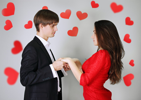 Young beautiful couple in love holding hands photo