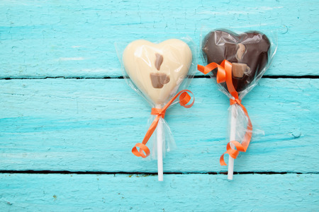 Chocolate candy on a stick in the form of heart