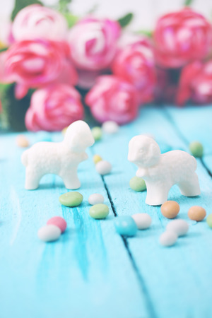 Easter  still life, lamb of white chocolate and candy photo
