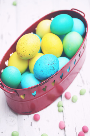 Easter still life basket of colored eggs photo