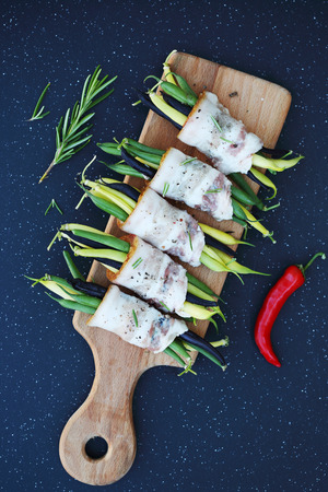 long bean: green beans wrapped in bacon with spices Stock Photo