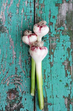Fresh garlic on a wooden board painted Archivio Fotografico