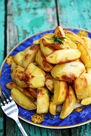 carbohydrates food: Baked potatoes with rosemary on the grill