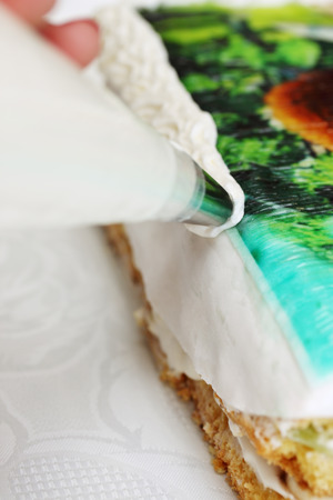 pastry bag: decorate cream cake from a pastry bag