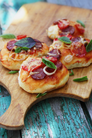 take out food: small homemade pizza on a wooden board