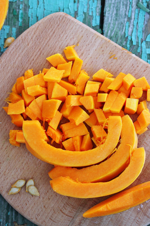 Juicy orange pumpkin on a wooden table