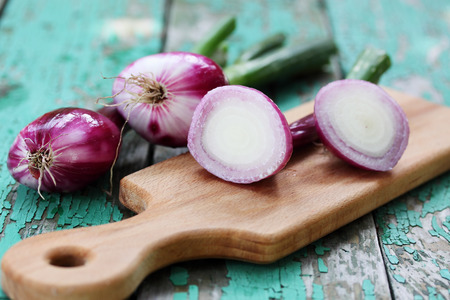 Fresh purple onion on a wooden board Stock Photo