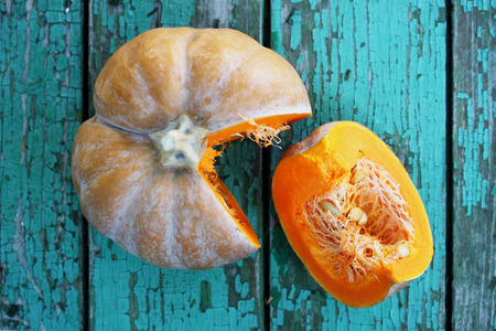 pumpkin seed: Juicy orange pumpkin on a wooden table