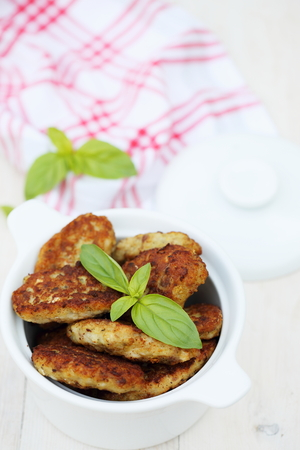 cutlets: fish cutlets countrylike  in white ceramic saucepan Stock Photo