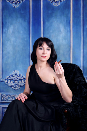 woman fur: A vintage woman smoking a cigar on blue background