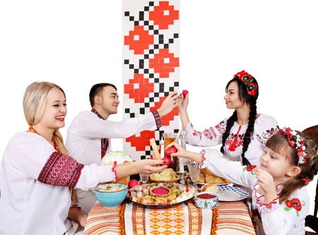 Slavic family at the festive Easter table with snacks