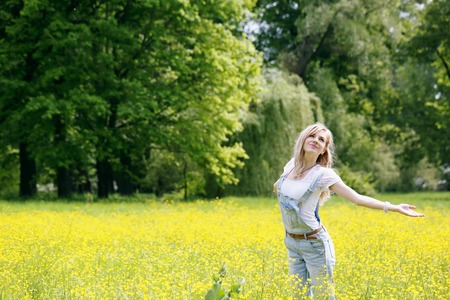 outstretched arms: Women enjoying nature in meadow. Outstretched arms fresh morning air summer Field at sunrise. Stock Photo