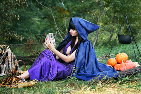 sabbath: sexy witch near a fire in the forest Stock Photo
